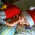 asleep in christmas hat after stressful festive day